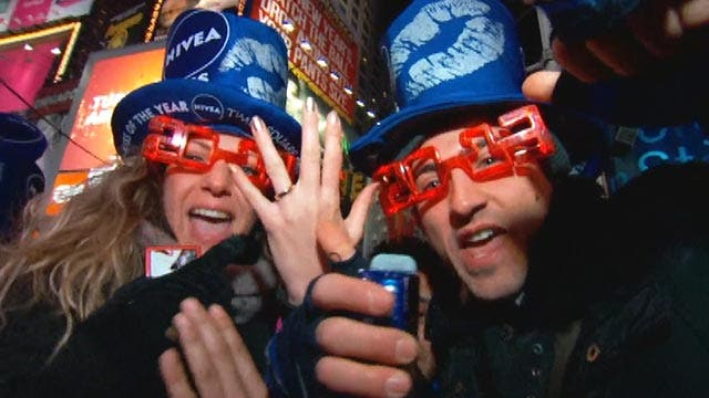Times Square revelers ring in 2013