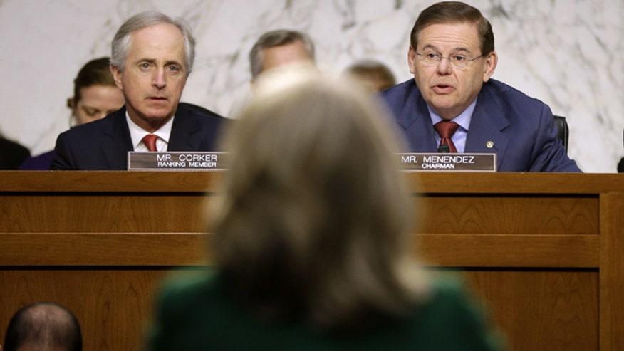 Sen. Robert Menendez (D-NJ), talks after Hillary Clinton's hearing on the Benghazi terrorist attack.