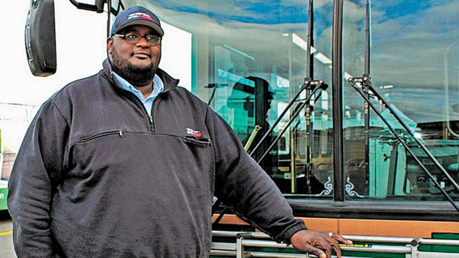 Bus driver hero talks woman off bridge