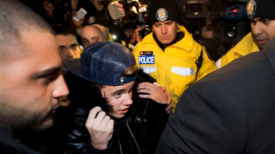 Justin Bieber turns himself in to police on an assault charge in Canada.