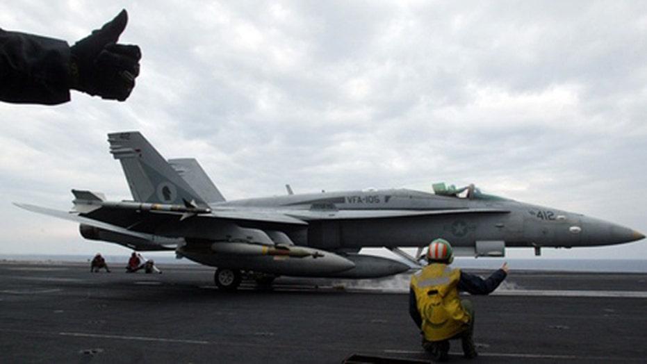 US warplanes hit Iraq militants firing on American personnel