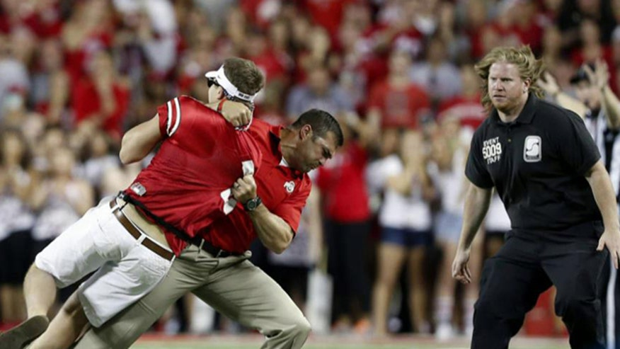 Ohio State coach body slams fan on field