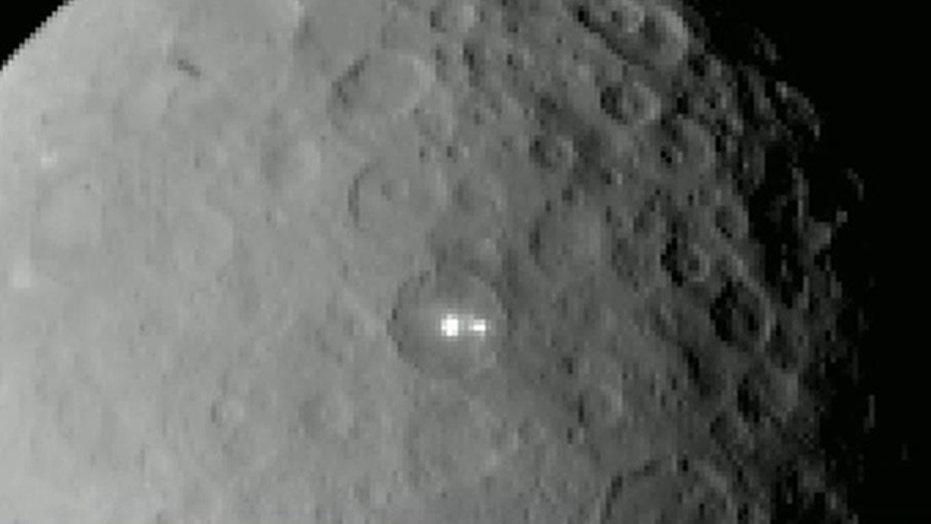 NASA probe discovers bright spots on dwarf planet