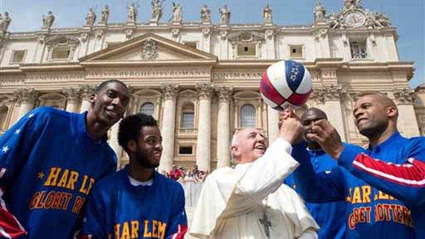 Pope Francis pulled off some basketball tricks in Saint Peter's Square under the guidance of The Harlem Globetrotters.