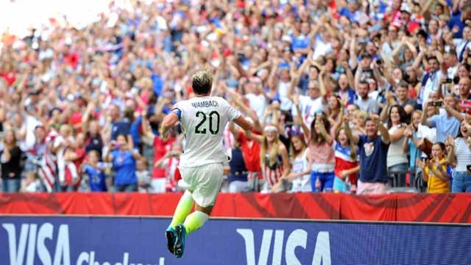 U.S. fans at World Cup celebrate Wambach's goal