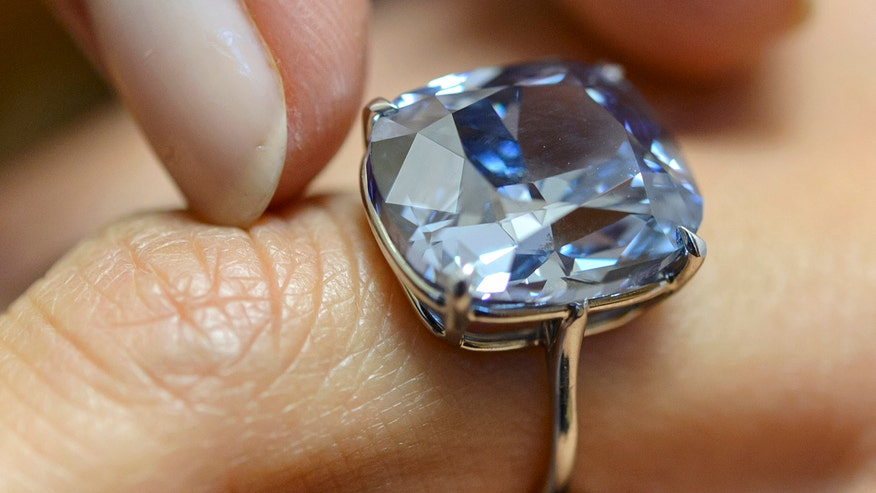 Hong Kong billionaire tycoon buys diamond for daughter at auction