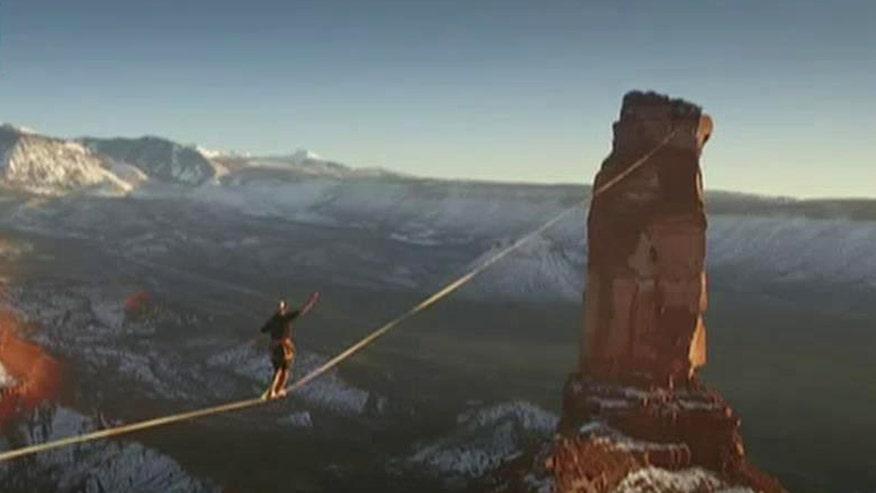 Adrenaline junky walks 1,600 feet between rock formations suspended 400 feet in air