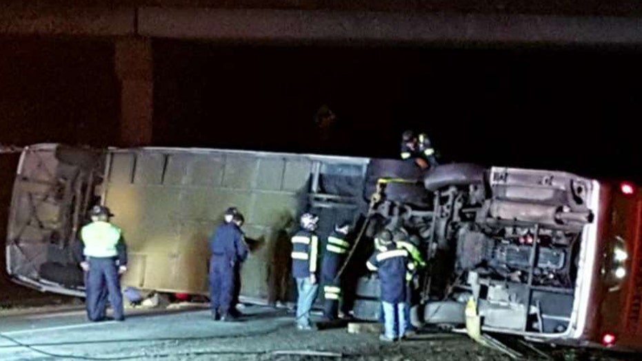 Charter bus overturns on highway, 35 injured
