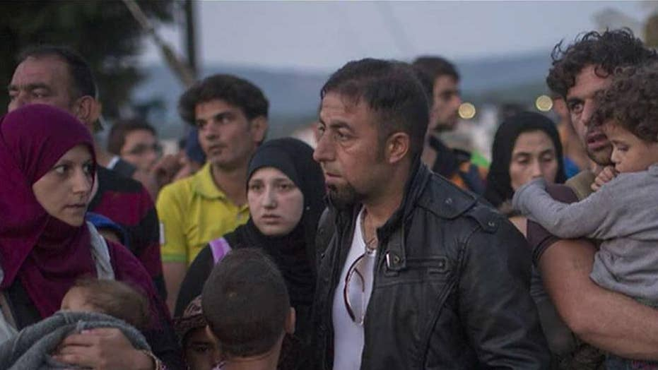 Texas threatens legal action over Syrian refugees