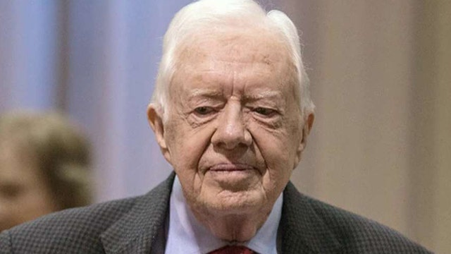 Jimmy Carter says recent brain scan shows no sign of cancer