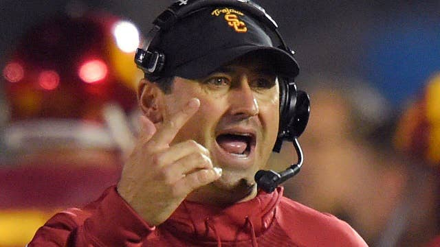 Former football coach sues USC for wrongful termination