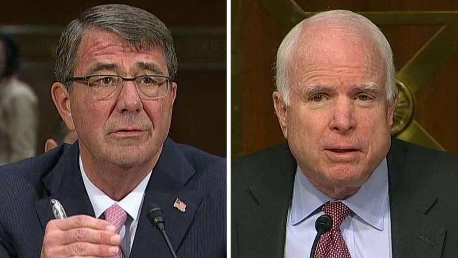 Tense exchange between McCain, Carter on containing ISIS