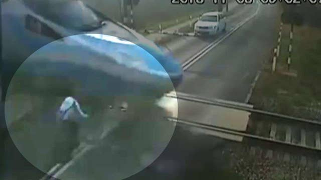 Oblivious cyclist runs straight into speeding train