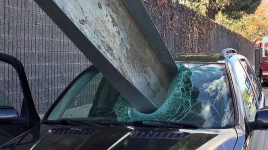 Massive I-beam impales car, just misses driver