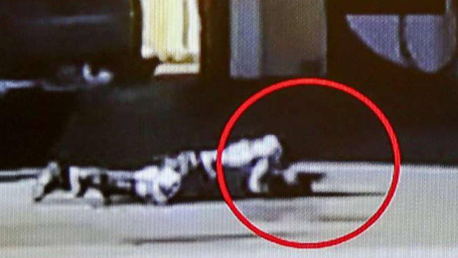 Video shows L.A. County deputies shooting armed man