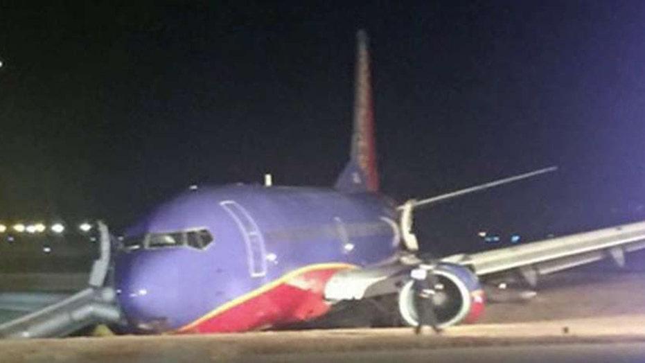 8 hurt after a Southwest jet skids off runway into ditch