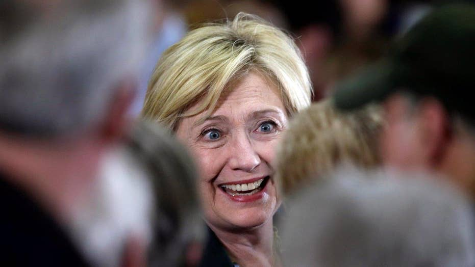 'I don't have horns': Clinton launches charm offensive