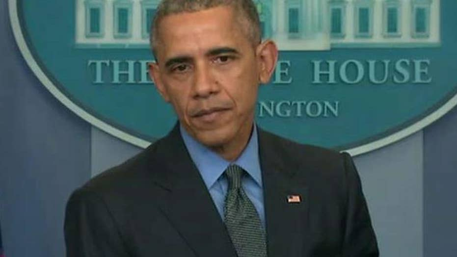 Obama touts successes, jabs opponents in year-end presser