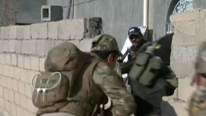 Iraqi troops in control of major section of the city, moving towards government building