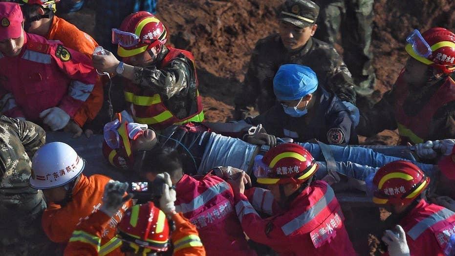 Man found alive after being buried 60 hours in landslide