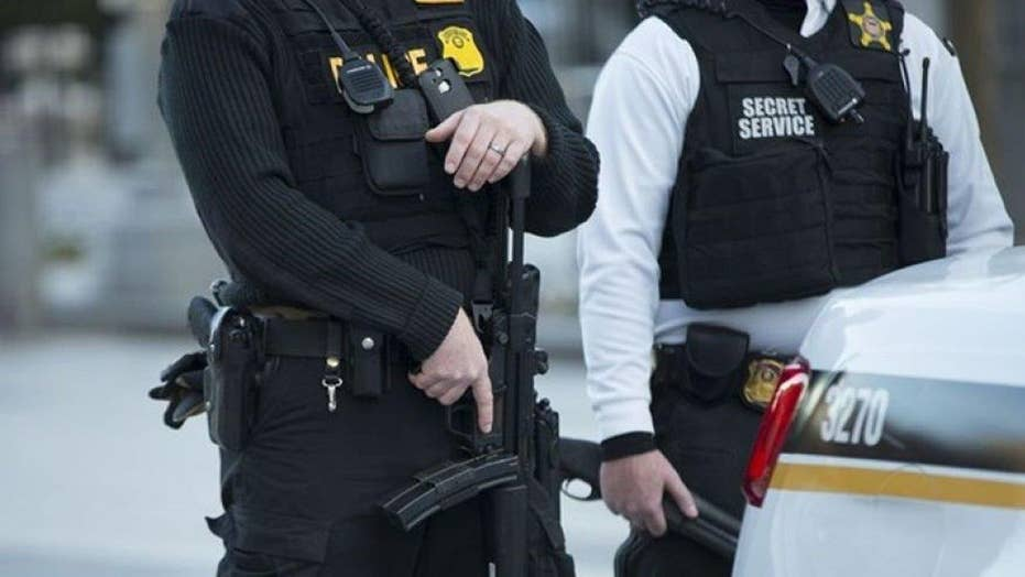 Secret Service agent's badge, gun stolen from car