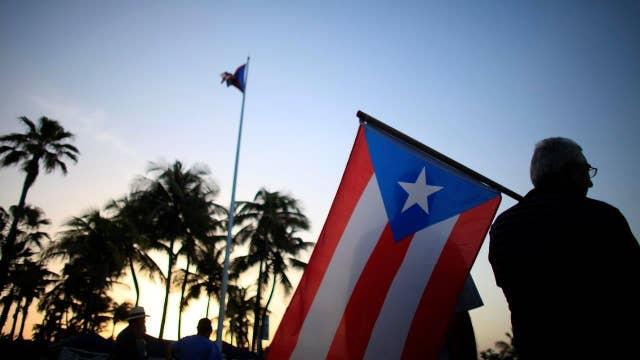 Debt-ridden Puerto Rico looks to Congress for help