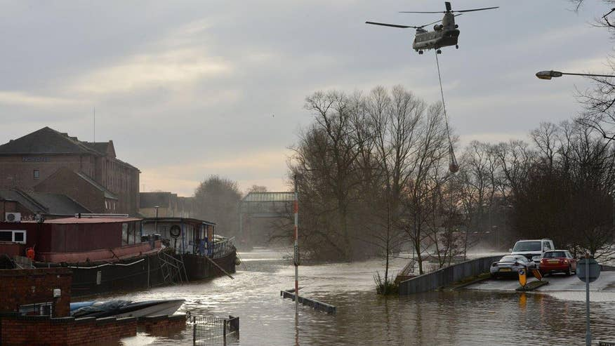 Prime Minister David Cameron visits areas affected by flooding