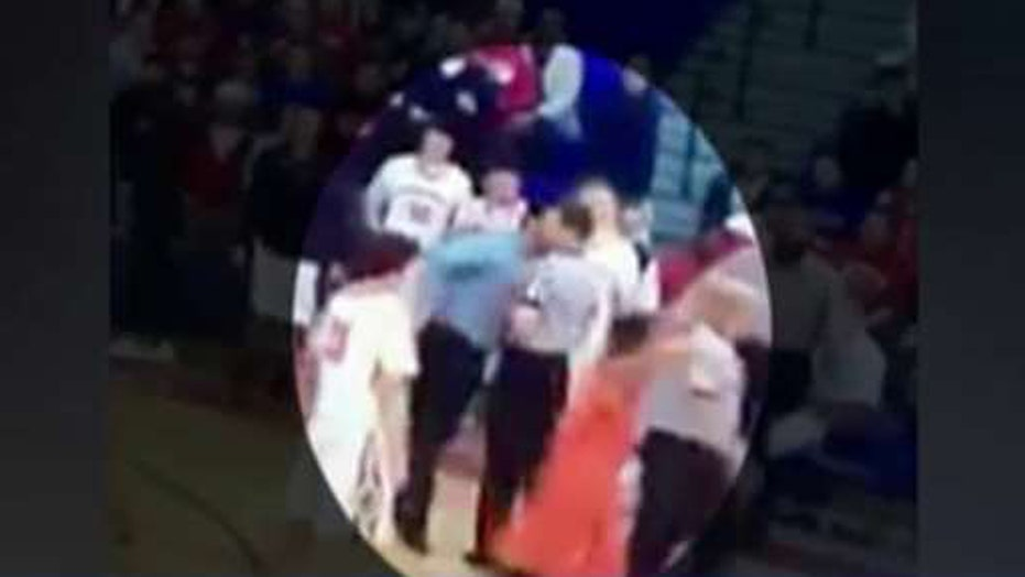 Coach knocks ref to floor with vicious head-butt