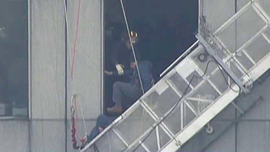 Crew trapped near 71st floor on Houston's tallest building