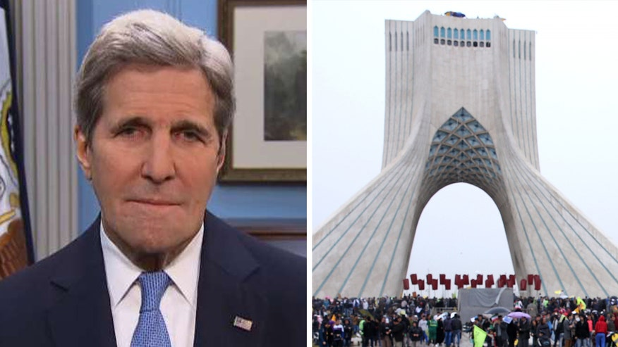 Secretary of state says it's 'absolutely a coincidence' that the U.S. announced it had imposed sanctions against 11 individuals and entities connected to Iran's ballistic missile program the day after four U.S. citizens were released from Iranian custody