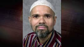 A controversial Ohio college professor, who has been under FBI investigation as an alleged ISIS sympathizer, has been suspended and banned from campus after federal officials filed charges against him Monday.