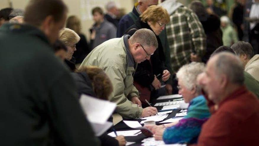 Mounting signs turnout for Iowa caucuses could hit record