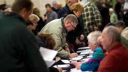 Do new voters show up and overwhelm the Iowa caucuses in a way they never have before?