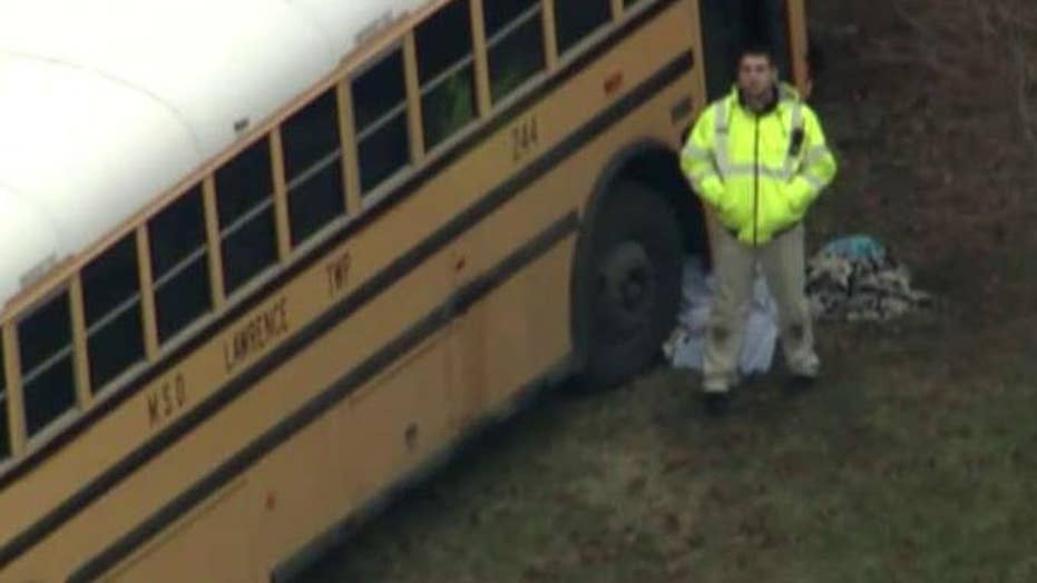 School principal saves students from bus before being killed