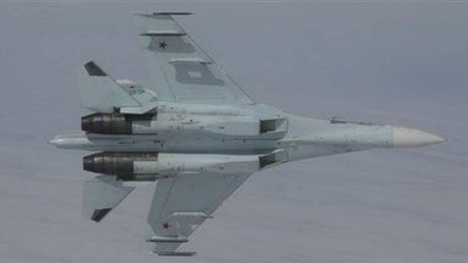Russian jet buzzes US Air Force spy plane