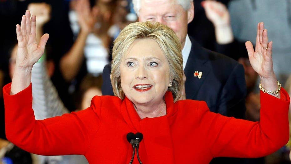 Hillary Clinton claims victory in Iowa after tight race