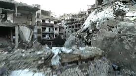 Skeletons of buildings stand vigil over a shattered landscape