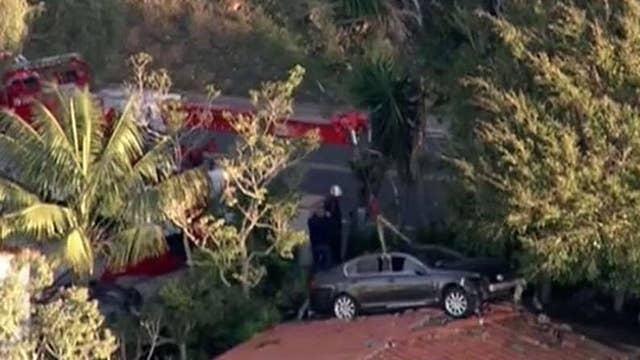 Car crash lands on roof in California