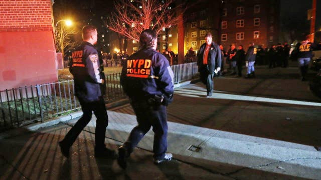 Investigators look for motive in shooting of two NYPD cops