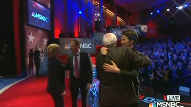 MSNBC debate moderator under fire for hugging candidates