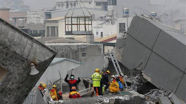At least 14 dead, 100 missing after earthquake hits Taiwan