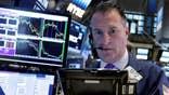 Stocks tumble as price of oil falls