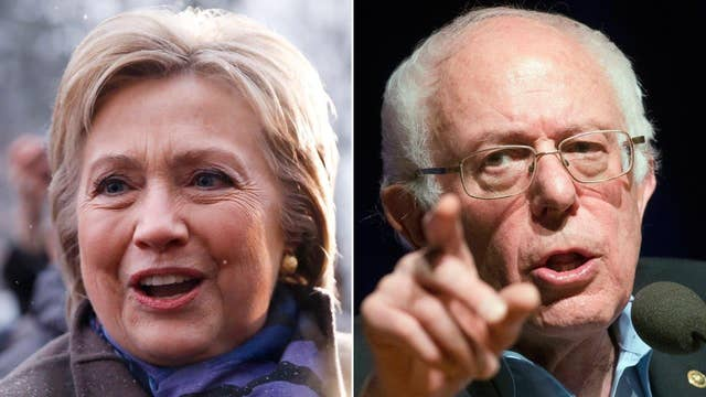 Clinton, Sanders make final push for votes on NH primary day