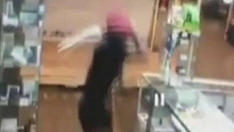 Video: Man attacks store clerk with sword