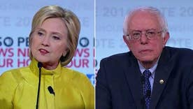 Clinton, Sanders clash over Obama, more at testy debate