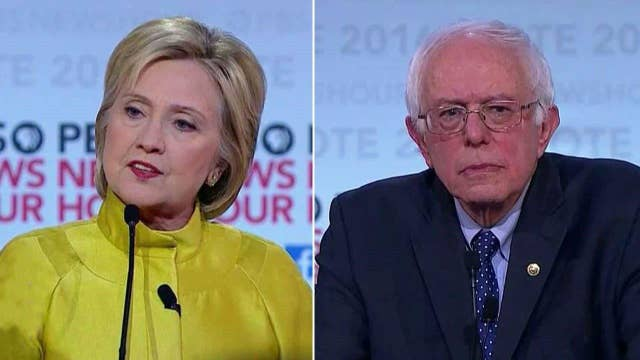 Sanders, Clinton clash over Wall St. campaign contributions