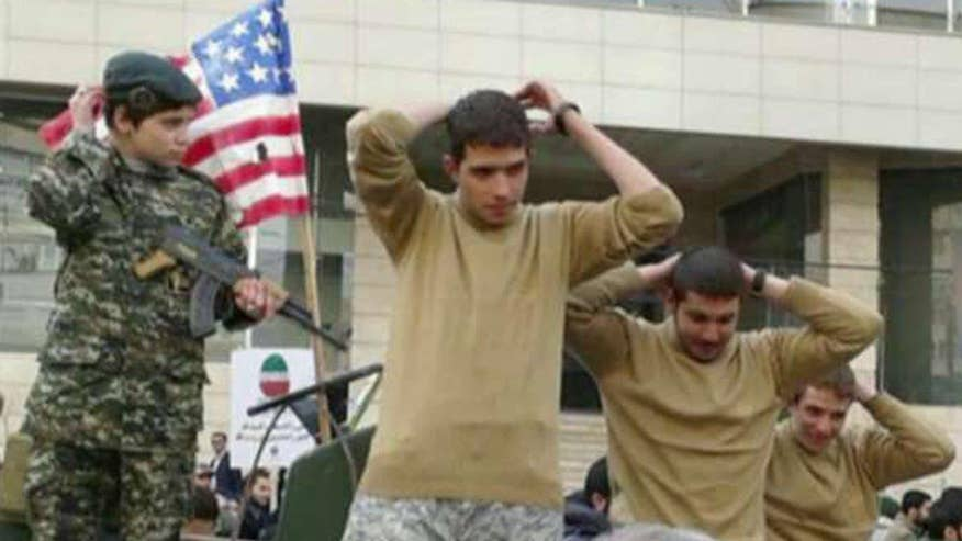 A parade float in Tehran mimics the U.S. sailors captured in Iranian waters in January