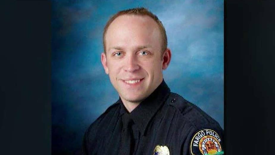 Officer Jason Moszer sustained 'non-survivable' wounds during a standoff with a domestic violence suspect