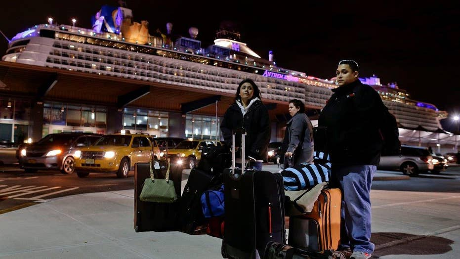 Storm-battered cruise ship returns to port
