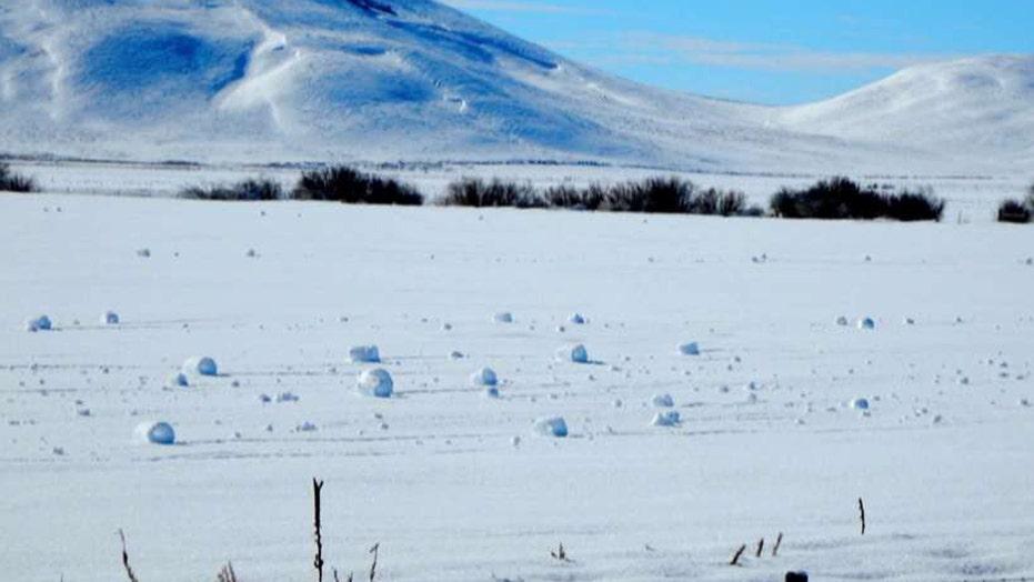 Rare natural phenomenon forms 'snow rollers' in Idaho